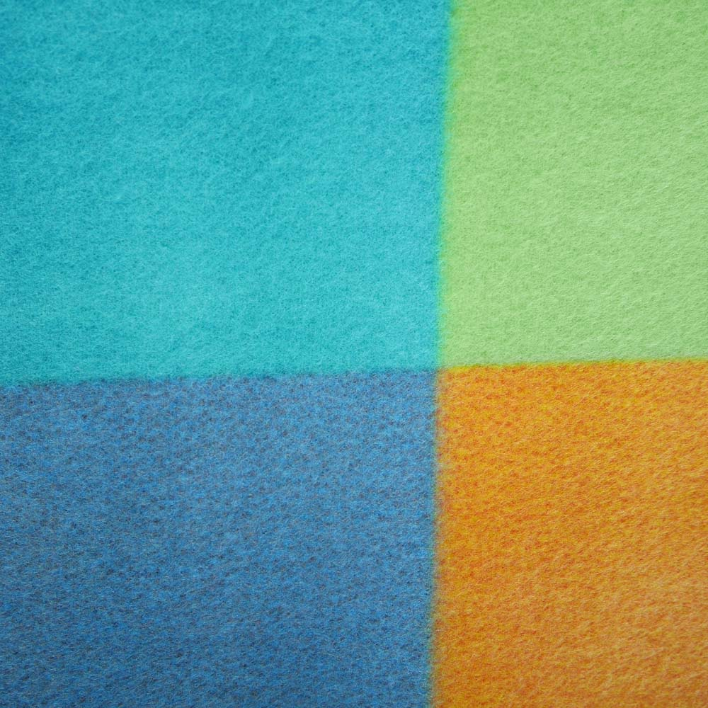 Close up of blue, green and orange picnic rug