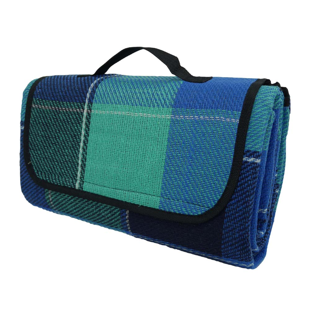 Blue tartan picnic blanket with black handle folded for easy carrying