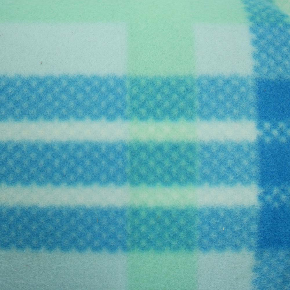 Close up of blue and green tartan extra large picnic blanket