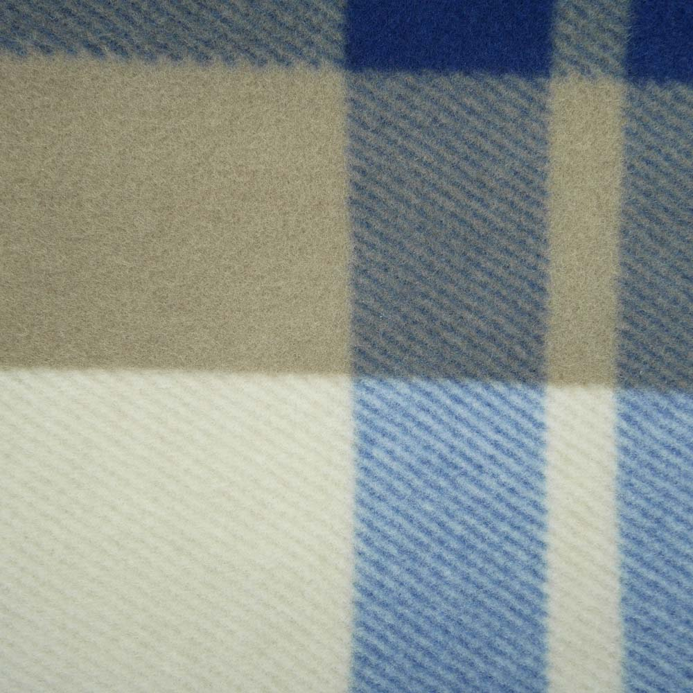 Close up of blue and brown tartan large picnic blanket