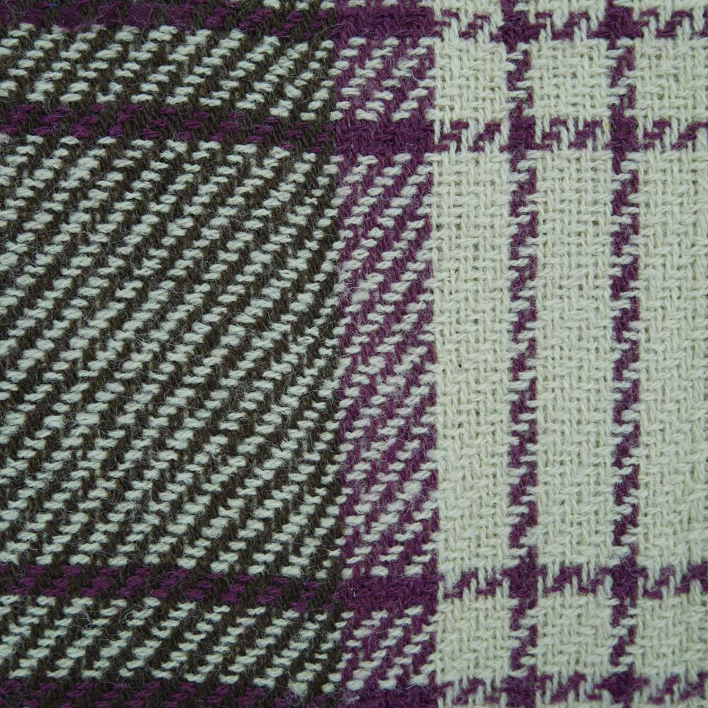 Close up of purple tartan picnic blanket