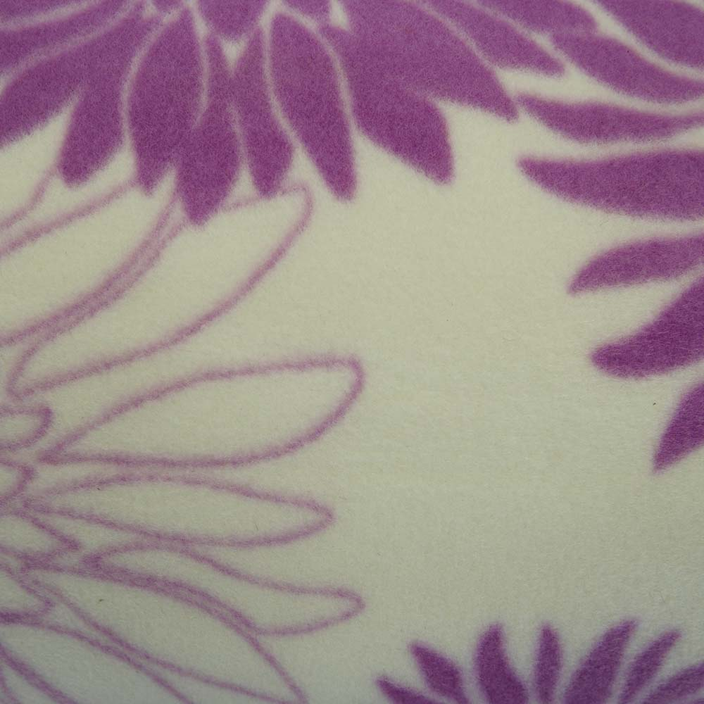 Close up of extra large picnic blanket with purple flowers