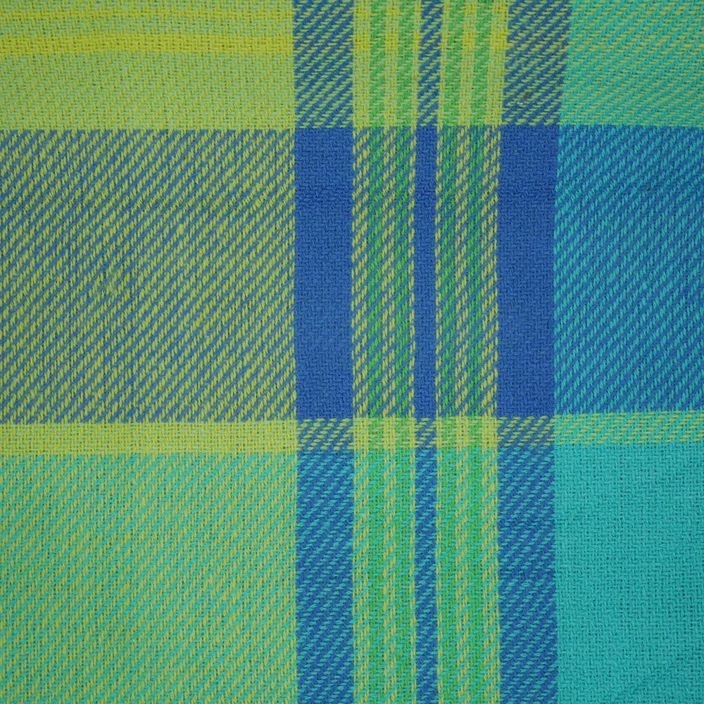 Close up of fancy blue, yellow and green picnic rug