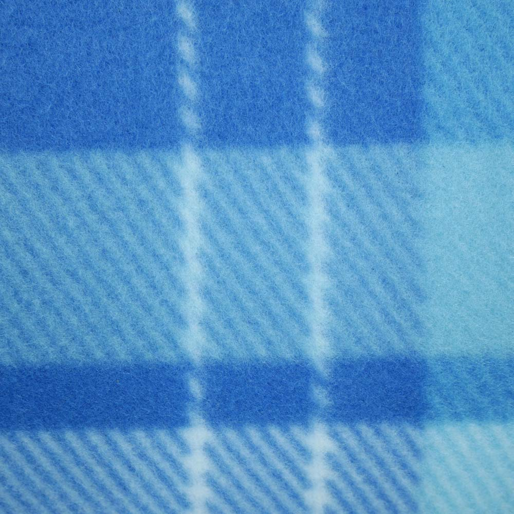 Close up of blue tartan pattern on large picnic blanket