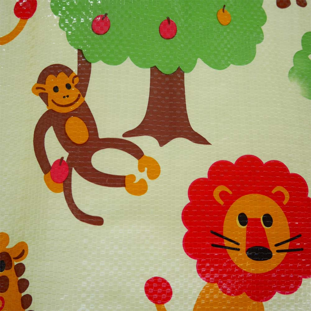 Close up of waterproof picnic mat with lions and monkey pattern