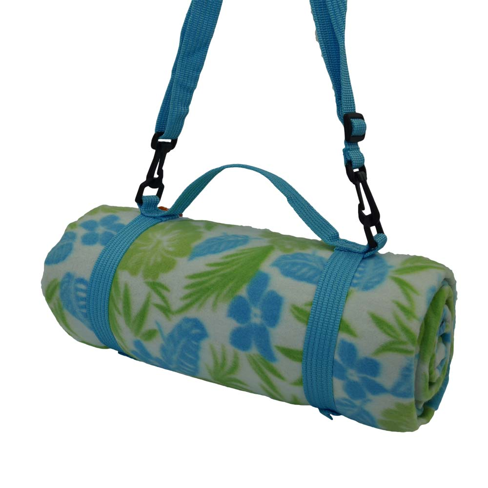 Colourful blue and green flowered picnic blanket with shoulder strap