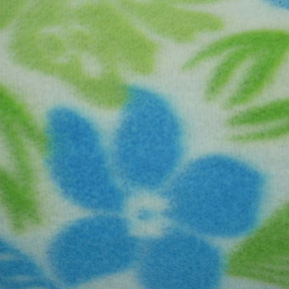 Close up of blue and green flower picnic blanket