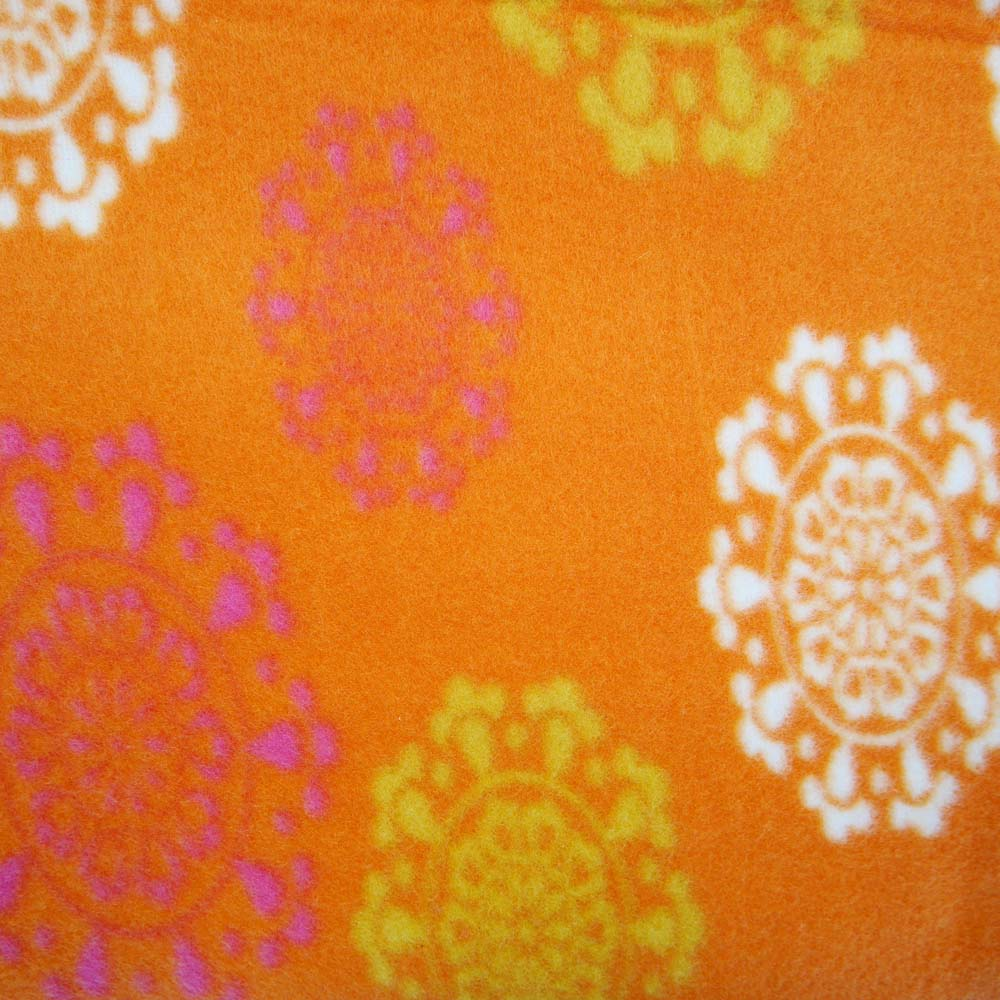 Close up of extra large picnic rug with orange pattern