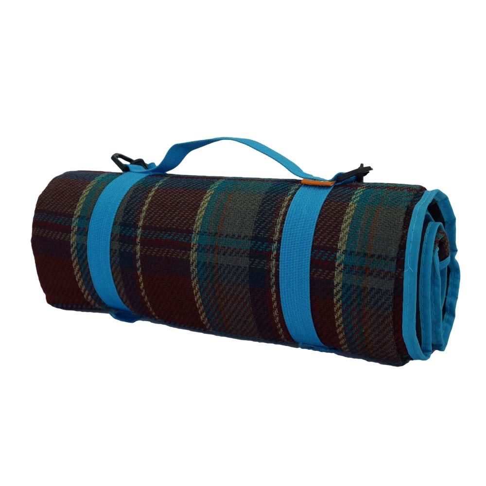 Maroon and blue tartan blanket with strap for easy transport