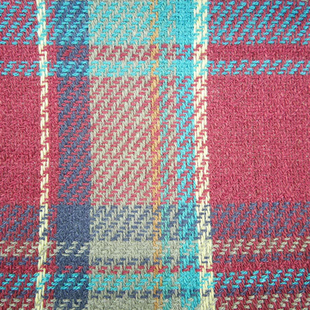 Close up of maroon and blue picnic rug